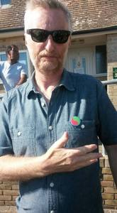 Billy Bragg wearing a PRBH badge
